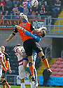 Hamilton keeper Michael McGovern collides with Dundee Utd's Jaroslaw Fojut.