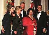 Elizabeth Taylor poses for a photo with United States President Bill Clinton and his family at the White House dinner on 31 December, 1999.  (L-R) Chelsea Clinton, First Lady Hillary Rodham Clinton, U.S. President Bill Clinton, Elizabeth Taylor, and Firooz Zahedi..Credit: Ron Sachs / CNP