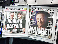 Front pages and headlines of the New York Post and Daily News tabloid newspapers on Wednesday, August 13, 2014 expand coverage of Monday's death of actor and comedian Robin Williams. Williams died in his Marin County, CA home at the age of 63, a suicide. (© Richard B. Levine)