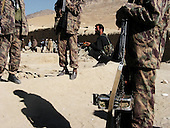 Maidan Shaher, Afghanistan<br /> November 24, 2001<br /> <br /> Maidan Shaher Province, District of Maidan Shaher<br /> <br /> The Taliban receive the Northern Alliance and journalist into the district of Maidan Shaher after a truce is struck between the two forces. Just two days ago the two fought each other in a serious battle over the territory.