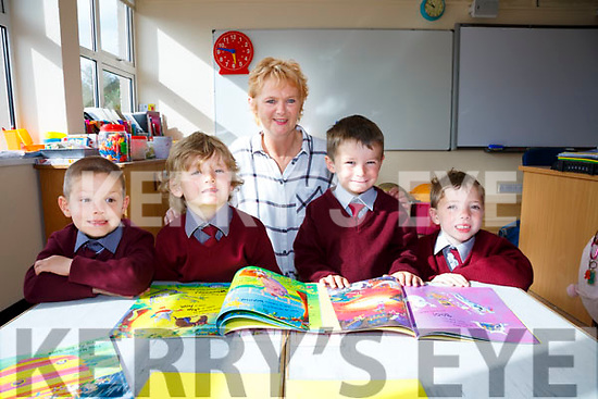 The four new juniors who started school in Scoil Dar Earca, Chapletown on Wednesday were l-r; Kajus Freitakas, Morgan Morrissey, Ben O'Donoghue, Tadhg O'Connell with their teacher Maeve Quirke.