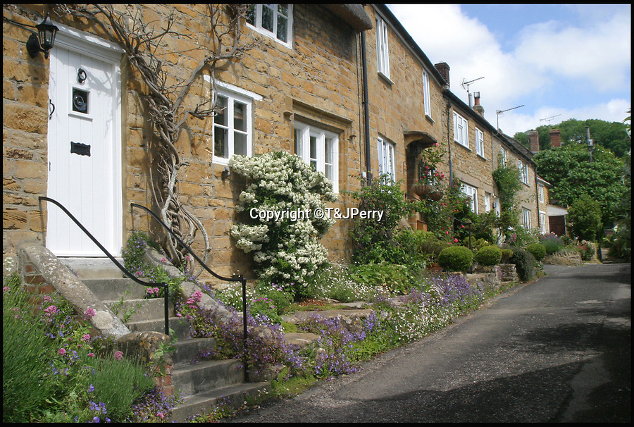BNPS.co.uk (01202 558833)<br /> Pic: T&JPerry/BNPS<br /> <br /> Fairplace today.<br /> <br /> The little changed Somerset village of Chiselborough whose residents have pieced together their history in photographs.<br /> <br /> A rural village's community has painstakingly put together its social history over the last 40 years, which is now going on display.<br /> <br /> Tony and June Perry first started collecting images of Chiselborough, in south Somerset, 40 years ago for the project which celebrates the village's people, traditions and buildings.<br /> <br /> Dozens of villagers have helped the couple compile 600 photos which are finally going to be shown in a new exhibition.<br /> <br /> The images, which date back to the 1860s, highlight many notable events in Chiselborough's history including the fire of 1890 which saw the pub burn down.<br /> <br /> Other photos show the silver jubilee party of 1935, a school fancy dress day in 1954 and the renovation of the village's 12th century church in 1971.<br /> <br /> Situated on the River Parrett, Chiselborough is five miles west of Yeovil and has a population of just 275 people.