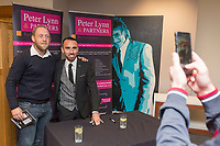 Leon Britton of Swansea City signs autographs in the 1912 Heritage Suite with adverts from Peter Lynn and Partners Solicitors after the final whistle of  the Premier League match between Swansea City and Leicester City at The Liberty Stadium, Swansea, Wales, UK. Saturday 21 October 2017