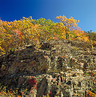 Landscape of rocky cliffs and trees in autumn. Harriman State Park, New York.