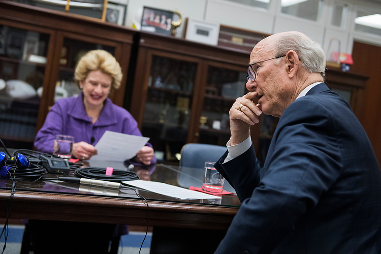 UNITED STATES - JULY 12: Senate Agriculture Committee Chairman Pat Roberts, R-Kan., right, and ranking member Sen. Debbie Stabenow, D-Mich., prepare for a podcast with CQ editor Shawn Zeller, off camera, in Hart Building on July 12, 2018. (Photo By Tom Williams/CQ Roll Call)