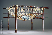 "Basket sculpture ""Honoring"" by artist June Kerseg-Hinson incorporating bamboo,bead and stone elements"