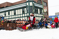 Laura Neese and team leave the ceremonial start line with an Iditarider and handler at 4th Avenue and D street in downtown Anchorage, Alaska on Saturday March 7th during the 2020 Iditarod race. Photo copyright by Cathy Hart Photography.com