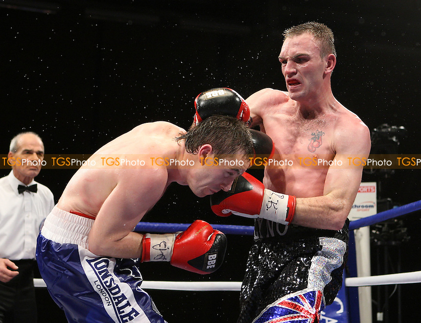 Colin Lynes (Hornchurch, black shorts) is defeated by Paul McCloskey (Dungiven, blue shorts) in a Boxing contest for the British Light-Welterweight Title at Goresbrook Leisure Centre, Dagenham, Essex promoted by Barry Hearn / Matchroom Sport -  05/12/08 - MANDATORY CREDIT: Gavin Ellis/TGSPHOTO - Self billing applies where appropriate - Tel: 0845 094 6026