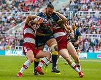 Warrington Wolves' Ben Murdoch-Masila is tackled by Wigan Warriors' Liam Farrell and Tony Clubb<br /> <br /> Photographer Alex Dodd/CameraSport<br /> <br /> Betfred Super League Round 15 - Magic Weekend - Wigan Warriors v Warrington Wolves - Saturday 19th May 2018 - St James' Park - Newcastle<br /> <br /> World Copyright &copy; 2018 CameraSport. All rights reserved. 43 Linden Ave. Countesthorpe. Leicester. England. LE8 5PG - Tel: +44 (0) 116 277 4147 - admin@camerasport.com - www.camerasport.com