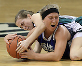 Tori Duffey, Waterford Our Lady of the Lakes, takes and elbow to the chin as she fights for a loose ball with Portland St. Patrick's Riley Smith during Class D semifinal action at the Breslin Center in Lansing Thursday, March 15, 2012.