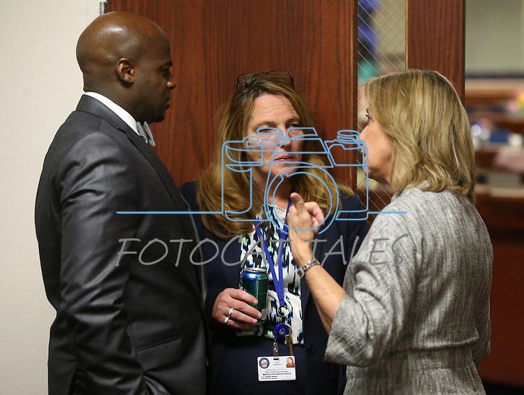 Nevada lawmakers, from left, Sen. Kelvin Atkinson, Assembly Speaker Marilyn Kirkpatrick and Sen. Barbara Cegavske talk during a special Legislative session in Carson City, Nev., on Tuesday, June 4, 2013. <br /> Photo by Cathleen Allison
