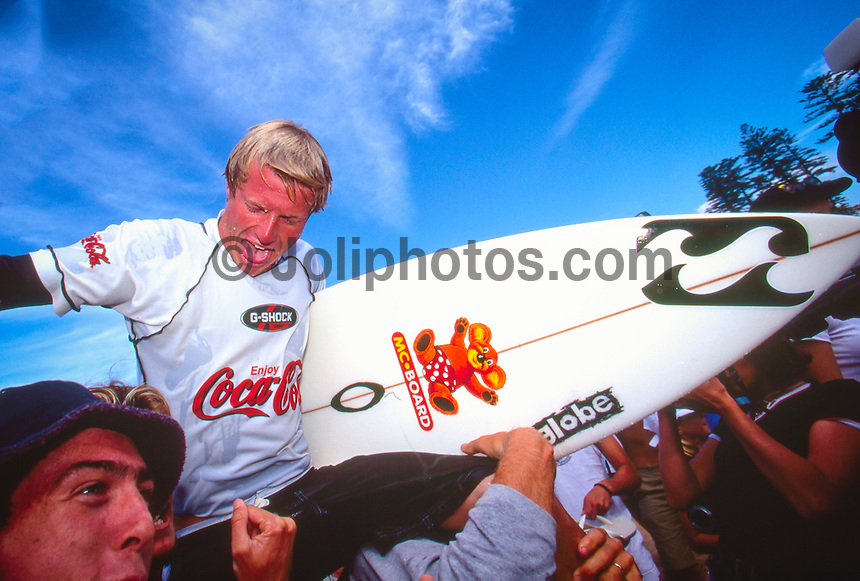 Taj Burrow (AUS) celebrating his first ASP WCT win at the 1999 Coke Surf Classic Manly, Sydney, Australia.<br /> <br /> Taj Burrow (AUS) was born on the 2nd June 1978, in Busselton, Western Australia. He caught his first waves when he was only seven and, ten years later, he earned a place in the ASP World Tour.<br /> <br /> However, Burrow declined the spot because he considered he was &quot;too young to do the tour full-on.&quot; One year later, the young gun claimed the &quot;Rookie of the Year&quot; award. Taj's first big win was at the 1999 Coke Surf Classic Manly, but he would conquer a total of 12 Dream Tour event trophies throughout his career.. Photo: joliphotos.com