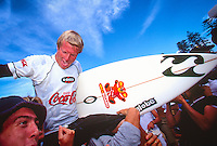 """Taj Burrow (AUS) celebrating his first ASP WCT win at the 1999 Coke Surf Classic Manly, Sydney, Australia.<br /> <br /> Taj Burrow (AUS) was born on the 2nd June 1978, in Busselton, Western Australia. He caught his first waves when he was only seven and, ten years later, he earned a place in the ASP World Tour.<br /> <br /> However, Burrow declined the spot because he considered he was """"too young to do the tour full-on."""" One year later, the young gun claimed the """"Rookie of the Year"""" award. Taj's first big win was at the 1999 Coke Surf Classic Manly, but he would conquer a total of 12 Dream Tour event trophies throughout his career.. Photo: joliphotos.com"""