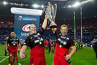 Petrus Du Plessis and Richard Barrington of Saracens lift the European Rugby Champions Cup trophy.  European Rugby Champions Cup Final, between Saracens and Racing 92 on May 14, 2016 at the Grand Stade de Lyon in Lyon, France. Photo by: Patrick Khachfe / Onside Images