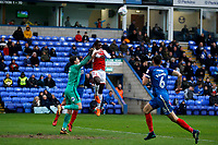 Jordy Hiwula of Fleetwood Town rises for the header as Jonathan Bond of Peterborough United looks to clear the danger during the Sky Bet League 1 match between Peterborough and Fleetwood Town at London Road, Peterborough, England on 28 April 2018. Photo by Carlton Myrie.