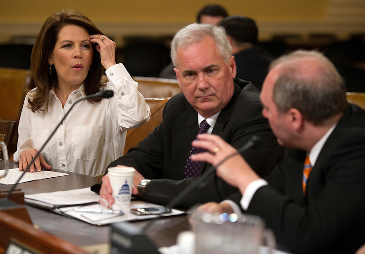 UNITED STATES - April 10 :  Rep. Michele Bachmann, R-Minn., Rep. Tom McClintock, R-CA., and Rep. Steve Scalise, R-LA., during the Oversight Subcommittee hearing on the government's ability to prioritize its obligations and continue operations should the U.S. Treasury reach its statutory debt limit on April 10, 2013.  (Photo By Douglas Graham/CQ Roll Call)