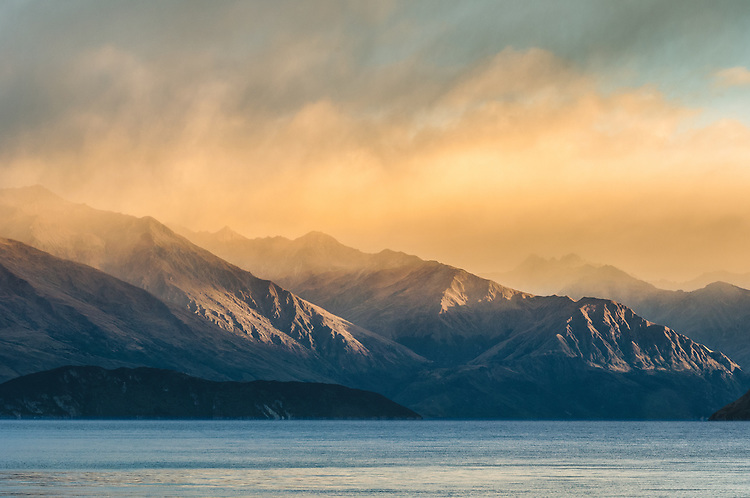 Close up of hazy sunlit  mountains and Lake Wanaka, South Island, New Zealand.