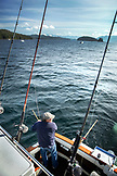ALASKA, Ketchikan, Captain Tony tending to his lines while fishing the Behm Canal near Clarence Straight, Knudsen Cove along the Tongass Narrows