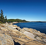Rock climbers on Otter Cliffs, Acadia National Park, Maine, USA