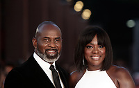 L'attrice statunitense Viola Davis (d) posa con il marito Julius Tennon (s) durante un red carpet alla 14^ Festa del Cinema di Roma all'Aufditorium Parco della Musica di Roma, 26 ottobre 2019.<br /> US actress Viola Davis (r) poses with her husband Julius Tennon (l) on a red carpet  during the 14^ Rome Film Fest at Rome's Auditorium, on 26 October 2019.<br /> UPDATE IMAGES PRESS/Isabella Bonotto