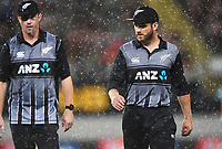 Colin Munro and Kane Williamson leave the field for rain.<br /> New Zealand Black Caps v Australia.Tri-Series International Twenty20 cricket final. Eden Park, Auckland, New Zealand. Wednesday 21 February 2018. &copy; Copyright Photo: Andrew Cornaga / www.Photosport.nz