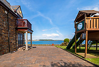 BNPS.co.uk (01202 558833)<br /> Pic: Savills/BNPS<br /> <br /> An idyllic coastal home with spectacular views over a picturesque bay has emerged for sale for £2.5m.<br /> <br /> Stack Point House in Falmouth, Cornwall, occupies a breathtaking clifftop plot which overlooks the vast Falmouth Bay.<br /> <br /> Built in the year 2000 it was designed specifically to make use of the beauty spot and enjoys uninterrupted panoramic sea views.