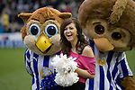 One of a group of display dancers is surprised by two giant Owl mascots before Sheffield Wednesday take on Peterborough United in a Coca-Cola Championship match at Hillsborough Stadium, Sheffield. The home side won by 2 goals to 1 giving Alan Irvine his third straight win since taking over as Wednesday's manager.