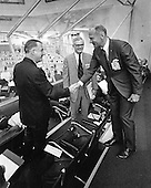 In this photo released by the National Aeronautics and Space Administration, Apollo 11 Lunar Module Pilot Edwin E. Aldrin, Jr., right, who is scheduled to make a lunar landing later this year with Neil A. Armstrong, greets United States Vice President Spiro T. Agnew, left, within the Spaceport's Launch Control Center at the the John F. Kennedy Space Center in Florida on March 3, 1969.  At this location, 3.5 miles from the launch pad, the Vice President viewed the launch of Apollo 9 Astronauts James A. McDivitt, David R. Scott, and Russell L. Schweikart.  In the center is Dr. Robert Seamans, Secretary of the Air Force and former NASA Administrator.  The Apollo 9 astronauts were launched into earth orbit today by a Saturn V rocket to test a lunar module spacecraft similar to the one that will land Astronauts Armstrong and Aldrin on the Moon. NASA directs the Apollo program.<br /> Credit: NASA via CNP