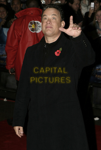 "TOM HANKS.Premiere of ""Polar Express"", Vue cinema, Leicester Square, London, November 17th 2004..half length hand gesture  funny.Ref: AH.www.capitalpictures.com.sales@capitalpictures.com.©Capital Pictures."