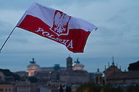 Polish flag is waved and Vittorio Emanuele's monument can be seen in the background.