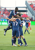 12 September 2012:  Chicago Fire players celebrate a goal by Chicago Fire midfielder Alvaro Fernandez #4 during an MLS game between the Chicago Fire and Toronto FC at BMO Field in Toronto, Ontario..The Chicago Fire won 2-1..