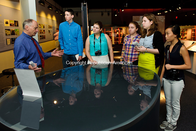 WATERBURY, CT - 31 July 2013-073113EC05--   High school interns with the Republican-American's Journalism Academy listen to Executive Editor Jonathan Kellogg discuss a display during a research trip to the Mattatuck Museum in downtown Waterbury. From L to R: Josh Eichenbaum, Anna Boris, Ireland Gilmore, Lauren Danielowski and Molly Richardson. Erin Covey Republican-American.