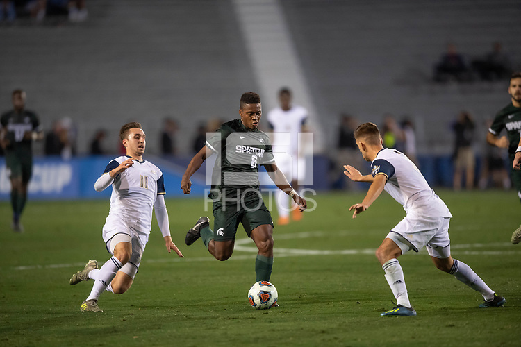 Santa Barbara, CA - Friday, December 7, 2018:  Akron men's soccer defeated Michigan State 5-1 in a semi-final match in the 2018 College Cup.  Michigan State's Delan Jones advances the ball.