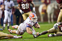November 29, 2008:    Florida quarterback Tim Tebow (15) dives for yardage during first half non-conference game action between the University of Florida Gators  and the Florida State Seminoles at Doak Campbell Stadium in Tallahassee, Florida.