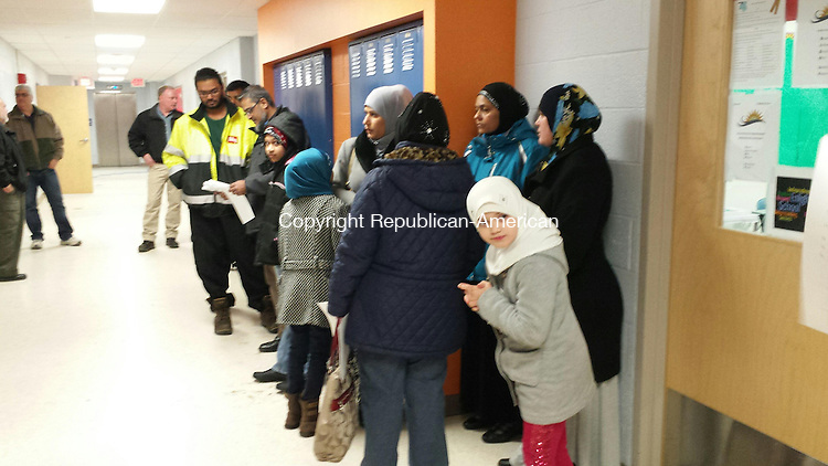 WATERBURY - A group of Muslims waits in the hall of the Enlightenment School for the start of Thursday's Board of Education meeting. Many Muslims had endorsed a petition seeking school recognition of two important religious holidays.
