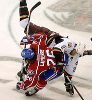 The Hershey Bears defenseman Troy Helm (2) checks Hamilton Bulldogs Maxim Lapierre (26) in the first period of game one in the AHL Calder Cup playoffs Friday, June 1, 2007 in Hershey, Pa. (AP Photo/Bradley C Bower)