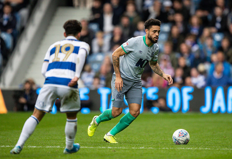 Blackburn Rovers' Derrick Williams breaks away from Queens Park Rangers' Ilias Chair (left) <br /> <br /> Photographer Andrew Kearns/CameraSport<br /> <br /> The EFL Sky Bet Championship - Queens Park Rangers v Blackburn Rovers - Saturday 5th October 2019 - Loftus Road - London<br /> <br /> World Copyright © 2019 CameraSport. All rights reserved. 43 Linden Ave. Countesthorpe. Leicester. England. LE8 5PG - Tel: +44 (0) 116 277 4147 - admin@camerasport.com - www.camerasport.com