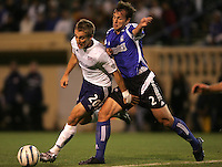 2 April 2005: Eddie Robinson of Earthquakes battles for the ball against Taylor Twellman of Revolutions during the second half of the game at Spartan Stadium in San Jose, California.   Earthquakes and Revolutions tied at 2-2.  Credit: Michael Pimentel / ISI