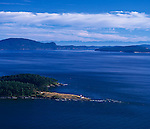 Spieden Channel, Henry and San Juan Islands from above Stuart Island, Olympic range in the distance