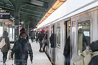 Passengers enter and depart a Flushing Line train in the Queensboro Plaza station in New York during Winter Storm Jonas on Saturday, January 23, 2016. Due to blizzard conditions approaching the MTA announced they will be suspending all above ground subway service as of 4:00 PM. (© Richard B. Levine)