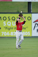 Kannapolis Intimidators left fielder Tyler Sullivan (5) settles under a fly ball during the game against the West Virginia Power at Kannapolis Intimidators Stadium on August 20, 2016 in Kannapolis, North Carolina.  The Intimidators defeated the Power 4-0.  (Brian Westerholt/Four Seam Images)