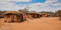 Traditional thatched mud huts in a Masai tribal village in Kenya, Africa (photo by Wildlife Photographer Matt Considine)