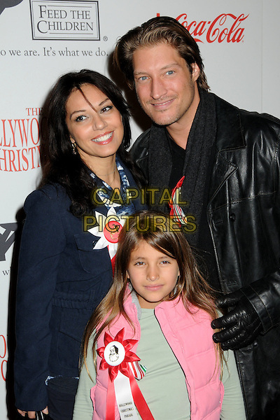 SEAN KANAN & FAMILY .Hollywood Christmas Parade 2009 Arrivals held at the Roosevelt Hotel, Hollywood, California, USA..November 29th, 2009.half length black leather jacket pink .CAP/ADM/BP.©Byron Purvis/AdMedia/Capital Pictures.