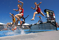 Iowa State's Jayden Russ (3498) and competitors leap through the water jump in the 3000 meter steeplechase Saturday, April 26, 2008 at the Drake Relays in Des Moines, Iowa.