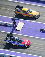 Apr. 28, 2012; Baytown, TX, USA: Aerial view of NHRA funny car driver Bob Tasca III (near lane) races alongside Jeff Arend during qualifying for the Spring Nationals at Royal Purple Raceway. Mandatory Credit: Mark J. Rebilas-