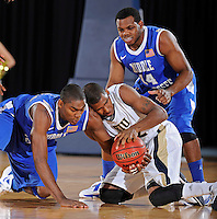 12 January 2012:  FIU's Jeremy Allen (32) fights for a lose ball in the first half as the Middle Tennessee State University Blue Raiders defeated the FIU Golden Panthers, 70-59, at the U.S. Century Bank Arena in Miami, Florida.