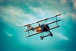 World War 1 German Fokker Dr1 tri plane in flight at high altitude