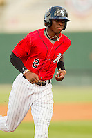 Tim Anderson (2) of the Kannapolis Intimidators rounds the bases against the Greenville Drive at CMC-Northeast Stadium on June 29, 2013 in Kannapolis, North Carolina.  The Intimidators defeated the Drive 9-3 in the completion of the game that began on June 28, 2013.   (Brian Westerholt/Four Seam Images)