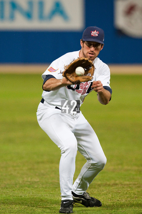 24 September 2009: Ike Davis of Team USA warms up prior to the 2009 Baseball World Cup final round match won 5-3 by Team USA over Cuba, in Nettuno, Italy.