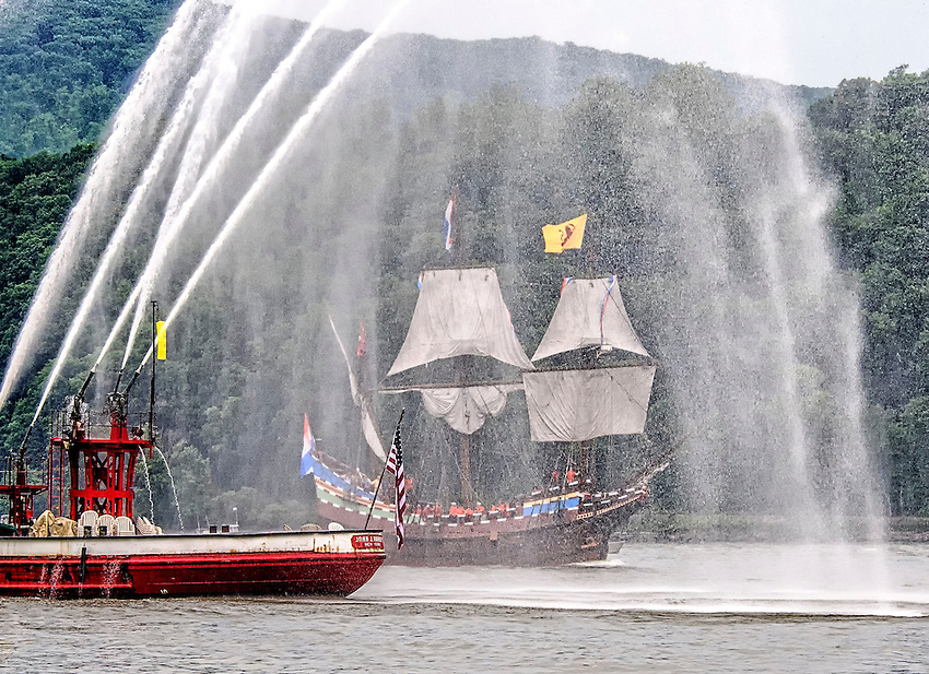 A fire boat spouts a wet welcome for the replica of Henry Hudson's ship Half Moon during a parade of tall ships up the Hudson River on the 400th anniversary of Hudson's first sail of discovery up the river.